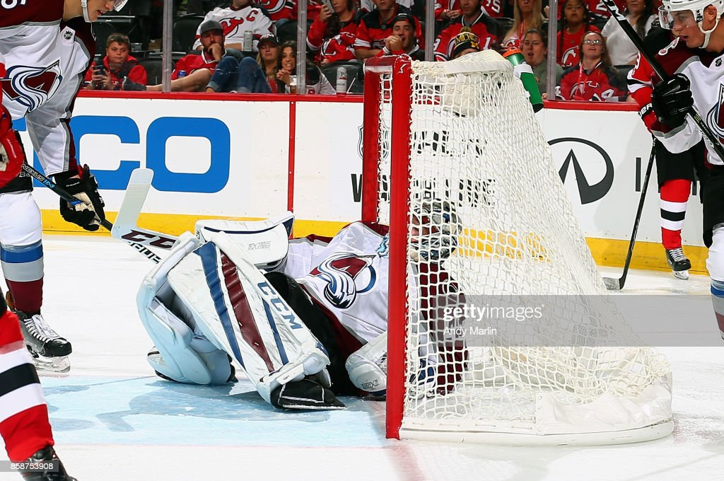 Jonathan Bernier #45 of the Colorado Avalanche makes a save lying on his back against the New Jersey Devils during the Devils season opener at Prudential Center on October 7, 2017 in Newark, New Jersey.