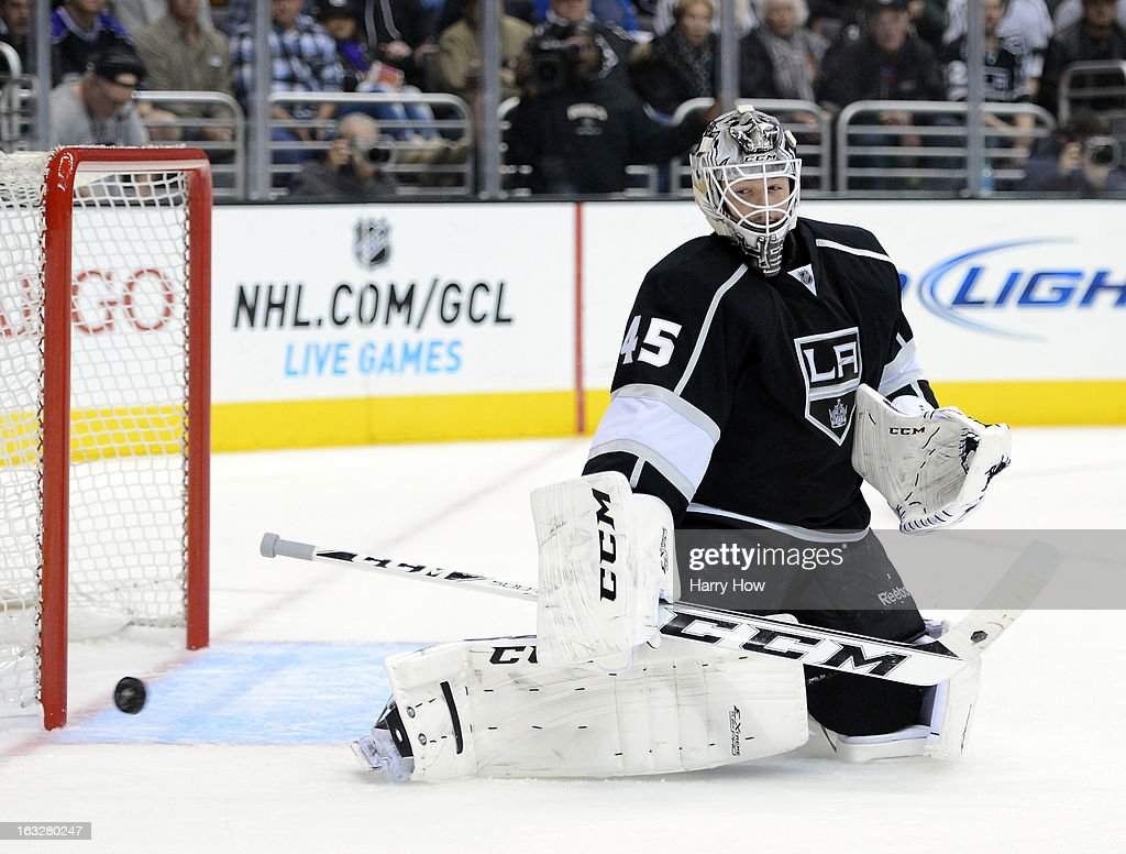 Jonathan Bernier #45 of the Los Angeles Kings makes a save against the Nashville Predators at Staples Center on March 4, 2013 in Los Angeles, California.