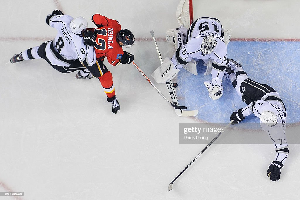 Jonathan Bernier #45 of the Los Angeles Kings stops the shot of Jarome Iginla #12 of the Calgary Flames during an NHL game at Scotiabank Saddledome on February 20, 2013 in Calgary, Alberta, Canada.