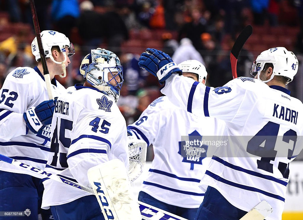 <a gi-track='captionPersonalityLinkClicked' href=/galleries/search?phrase=Jonathan+Bernier&family=editorial&specificpeople=540491 ng-click='$event.stopPropagation()'>Jonathan Bernier</a> #45 of the Toronto Maple Leafs celebrates a 4-0 win over the Anaheim Ducks with Martin Marincin #52, <a gi-track='captionPersonalityLinkClicked' href=/galleries/search?phrase=Roman+Polak&family=editorial&specificpeople=2109482 ng-click='$event.stopPropagation()'>Roman Polak</a> #46 and <a gi-track='captionPersonalityLinkClicked' href=/galleries/search?phrase=Nazem+Kadri&family=editorial&specificpeople=4043234 ng-click='$event.stopPropagation()'>Nazem Kadri</a> #43 at Honda Center on January 6, 2016 in Anaheim, California.