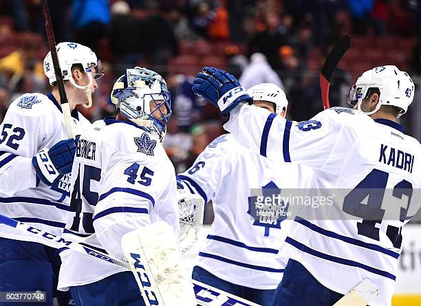 Jonathan Bernier of the Toronto Maple Leafs celebrates a 40 win over the Anaheim Ducks with Martin Marincin Roman Polak and Nazem Kadri at Honda...