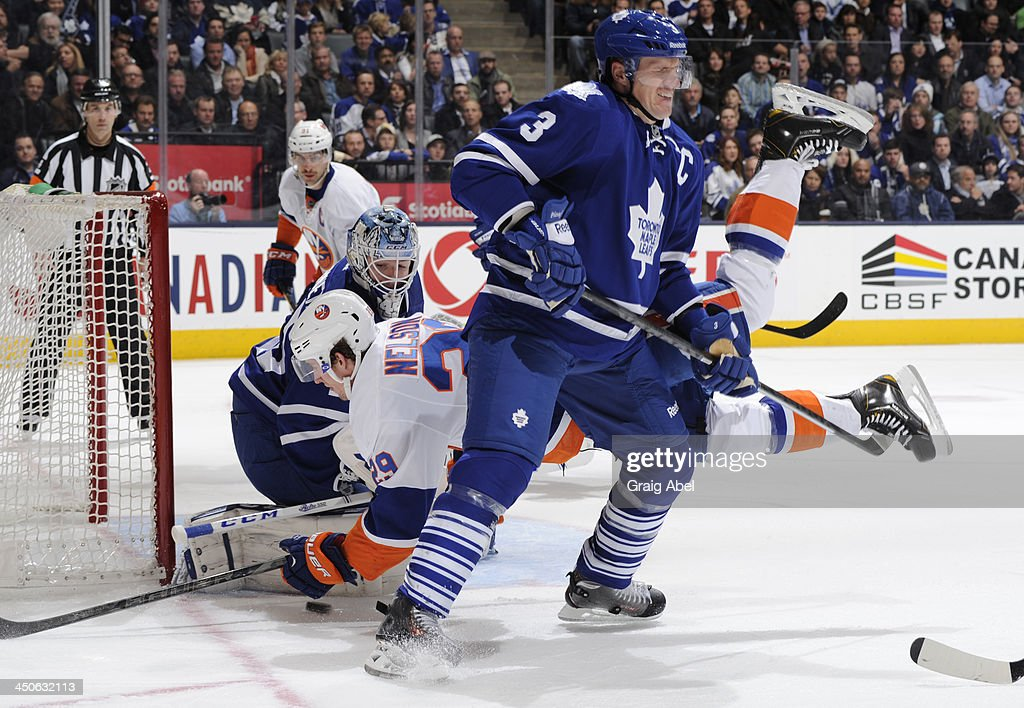 <a gi-track='captionPersonalityLinkClicked' href=/galleries/search?phrase=Jonathan+Bernier&family=editorial&specificpeople=540491 ng-click='$event.stopPropagation()'>Jonathan Bernier</a> #45 of the Toronto Maple Leafs defends the goal as teammate <a gi-track='captionPersonalityLinkClicked' href=/galleries/search?phrase=Dion+Phaneuf&family=editorial&specificpeople=545455 ng-click='$event.stopPropagation()'>Dion Phaneuf</a> #3 trips up <a gi-track='captionPersonalityLinkClicked' href=/galleries/search?phrase=Brock+Nelson&family=editorial&specificpeople=7029374 ng-click='$event.stopPropagation()'>Brock Nelson</a> #29 of the New York Islanders during NHL game action November 19, 2013 at the Air Canada Centre in Toronto, Ontario, Canada.