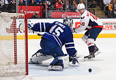 Jonathan Bernier of the Toronto Maple Leafs defends the goal with Nicklas Backstrom of the Washington Capitals on the doorstep during NHL game action...