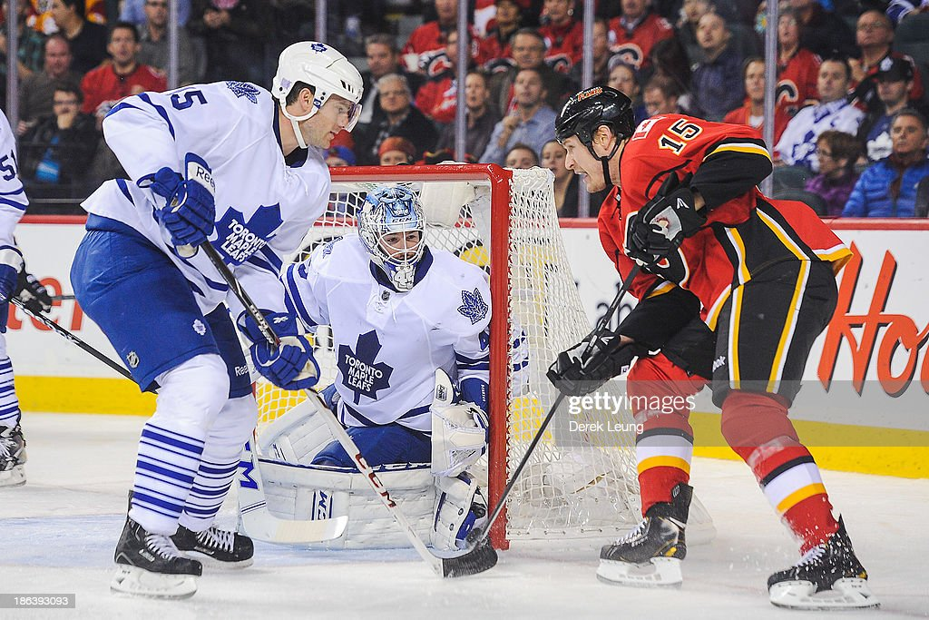 <a gi-track='captionPersonalityLinkClicked' href=/galleries/search?phrase=Jonathan+Bernier&family=editorial&specificpeople=540491 ng-click='$event.stopPropagation()'>Jonathan Bernier</a> #45 of the Toronto Maple Leafs defends the net against <a gi-track='captionPersonalityLinkClicked' href=/galleries/search?phrase=Tim+Jackman&family=editorial&specificpeople=2077074 ng-click='$event.stopPropagation()'>Tim Jackman</a> #15 of the Calgary Flames during an NHL game at Scotiabank Saddledome on October 30, 2013 in Calgary, Alberta, Canada.
