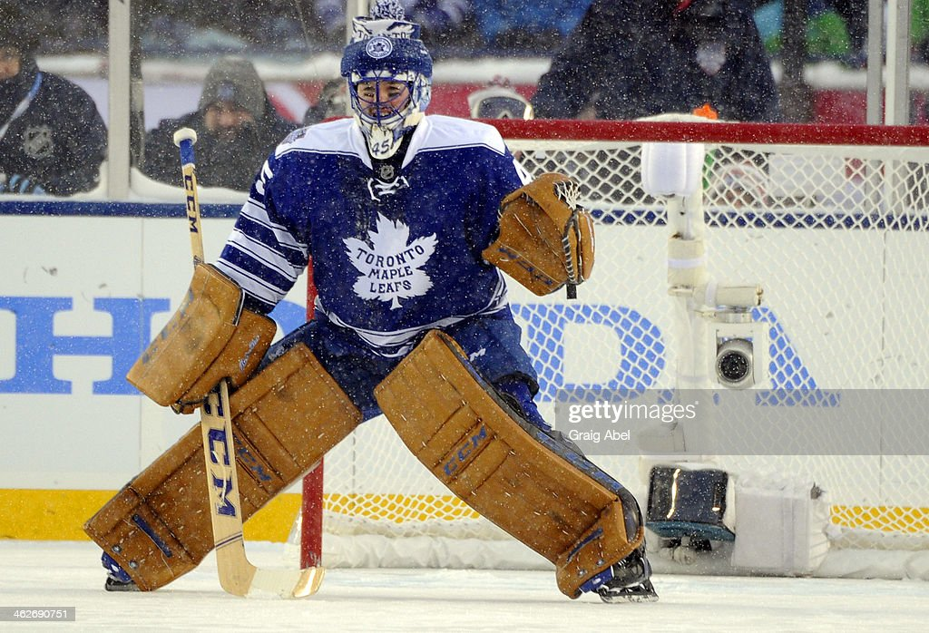 Jonathan Bernier #45 of the Toronto Maple Leafs guards the net against the Detroit Red Wings during NHL game action during the 2014 Bridgestone NHL Winter Classic January 1, 2014 at Michigan Stadium in Ann Arbor, Michigan.