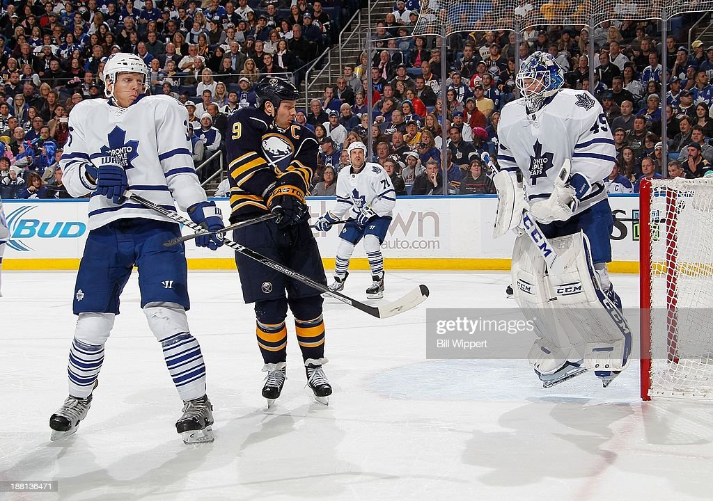<a gi-track='captionPersonalityLinkClicked' href=/galleries/search?phrase=Jonathan+Bernier&family=editorial&specificpeople=540491 ng-click='$event.stopPropagation()'>Jonathan Bernier</a> #45 of the Toronto Maple Leafs jumps to make a third period save behind teammate <a gi-track='captionPersonalityLinkClicked' href=/galleries/search?phrase=Carl+Gunnarsson&family=editorial&specificpeople=5557315 ng-click='$event.stopPropagation()'>Carl Gunnarsson</a> #36 and <a gi-track='captionPersonalityLinkClicked' href=/galleries/search?phrase=Steve+Ott&family=editorial&specificpeople=210616 ng-click='$event.stopPropagation()'>Steve Ott</a> #9 of the Buffalo Sabres on November 15, 2013 at the First Niagara Center in Buffalo, New York. Buffalo won, 3-1.