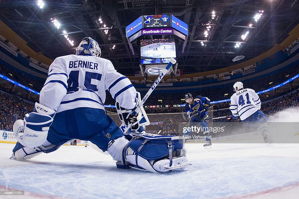 <a gi-track='captionPersonalityLinkClicked' href=/galleries/search?phrase=Jonathan+Bernier&family=editorial&specificpeople=540491 ng-click='$event.stopPropagation()'>Jonathan Bernier</a> #45 of the Toronto Maple Leafs makes a save against <a gi-track='captionPersonalityLinkClicked' href=/galleries/search?phrase=David+Backes&family=editorial&specificpeople=2538492 ng-click='$event.stopPropagation()'>David Backes</a> #42 of the St. Louis Blues at the Scottrade Center on December 12, 2013 in St. Louis, Missouri. The Blues beat the Leafs 6-3.