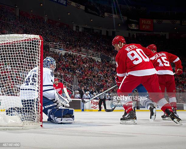 Jonathan Bernier of the Toronto Maple Leafs makes a save as Stephen Weiss of the Detroit Red Wings goes to the net during a NHL game on October 18...