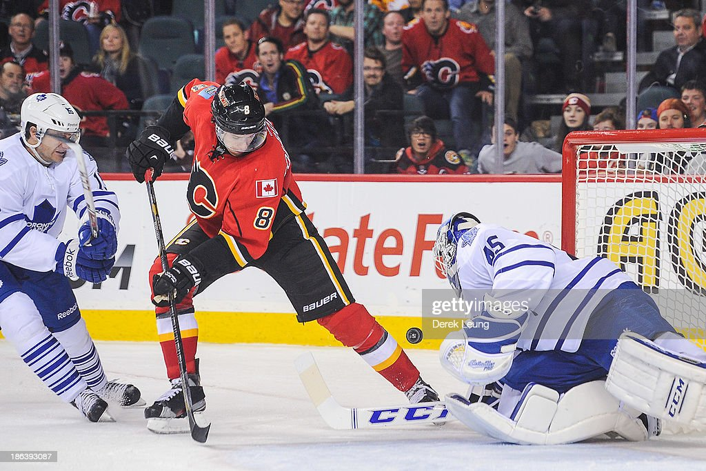 <a gi-track='captionPersonalityLinkClicked' href=/galleries/search?phrase=Jonathan+Bernier&family=editorial&specificpeople=540491 ng-click='$event.stopPropagation()'>Jonathan Bernier</a> #45 of the Toronto Maple Leafs makes a save on the shot of <a gi-track='captionPersonalityLinkClicked' href=/galleries/search?phrase=Joe+Colborne&family=editorial&specificpeople=5370968 ng-click='$event.stopPropagation()'>Joe Colborne</a> #8 of the Calgary Flames during an NHL game at Scotiabank Saddledome on October 30, 2013 in Calgary, Alberta, Canada.