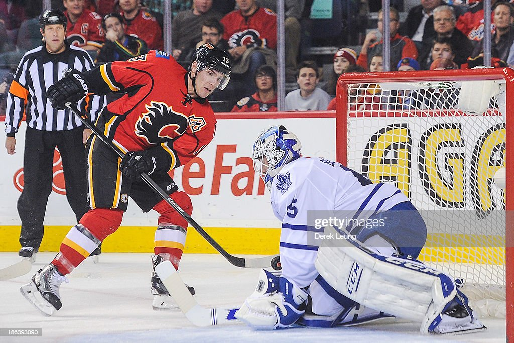 <a gi-track='captionPersonalityLinkClicked' href=/galleries/search?phrase=Jonathan+Bernier&family=editorial&specificpeople=540491 ng-click='$event.stopPropagation()'>Jonathan Bernier</a> #45 of the Toronto Maple Leafs stops the shot of <a gi-track='captionPersonalityLinkClicked' href=/galleries/search?phrase=Mike+Cammalleri&family=editorial&specificpeople=634009 ng-click='$event.stopPropagation()'>Mike Cammalleri</a> #13 of the Calgary Flames during an NHL game at Scotiabank Saddledome on October 30, 2013 in Calgary, Alberta, Canada.
