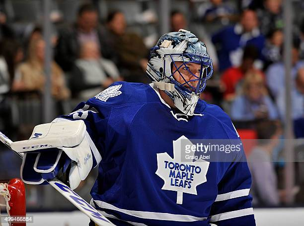Jonathan Bernier of the Toronto Maple Leafs takes a break against the Washington Capitals during game action on November 28 2015 at Air Canada Centre...