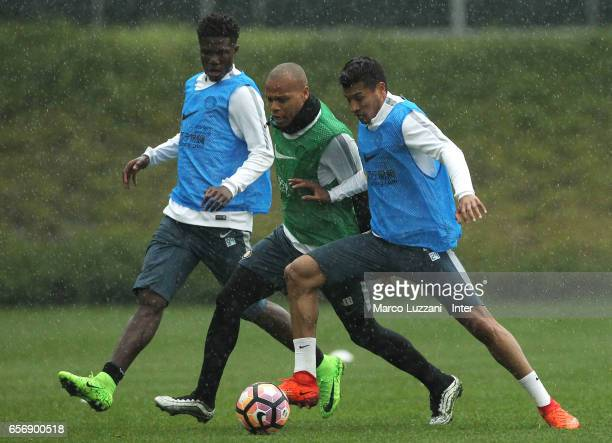 Jonathan Biabiany competes with Eloge Koffi Yao Guy and Jeison Murillo of FC Internazionale looks on during the FC Internazionale training session at...