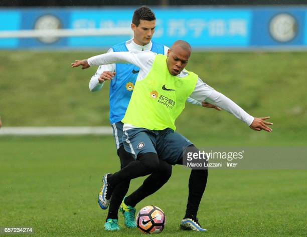 Jonathan Biabiany is challenged by Marco Andreolli during the FC Internazionale training session at the club's training ground Suning Training Center...