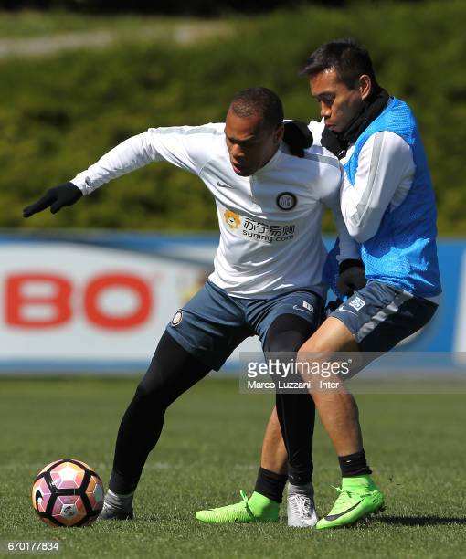 Jonathan Biabiany is challenged by Yuto Nagatomo during the FC Internazionale training session at the club's training ground Suning Training Center...