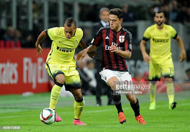 Jonathan Biabiany of FC Internazionale competes for the ball with Davide Calabria of AC Milan during the Berlusconi Trophy match between AC Milan and...