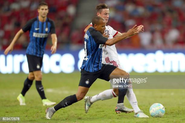 Jonathan Biabiany of FC Internazionale holds off Marco Friedl of the FC Bayern during the International Champions Cup match between FC Bayern and FC...