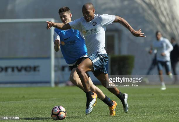 Jonathan Biabiany of FC Internazionale is challenged during the FC Internazionale training session at the club's training ground Suning Training...