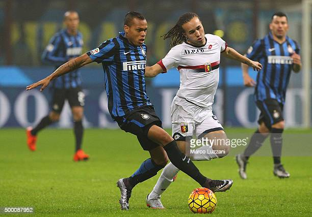 Jonathan Biabiany of FC Internazionale Milano competes for the ball with Suarez Diego Sebastian Laxalt of Genoa CFC during the Serie A match between...