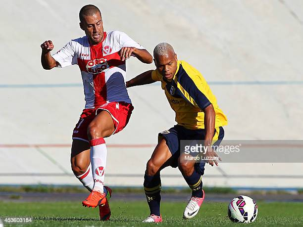 Jonathan Biabiany of FC Parma competes for the ball with Nunzio Di Roberto of AS Varese during the preseason friendly match between AS Varese and FC...