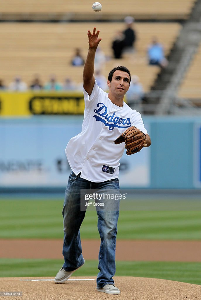 Jonathan Bornstein of MLS soccer team Chivas USA throws out the first pitch prior to the start of the game between the Los Angeles Dodgers and the Colorado Rockies at Dodger Stadium on May 9, 2010 in Los Angeles, California. The Dodgers defeated the Rockies 2-0.