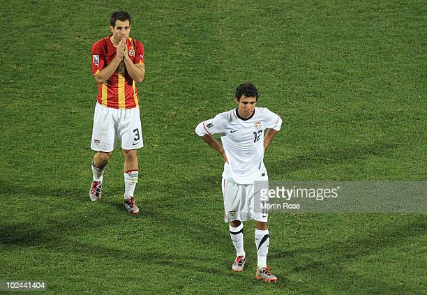 Jonathan Bornstein of the United States and Carlos Bocanegra look dejected after losing to Ghana during the 2010 FIFA World Cup South Africa Round of...
