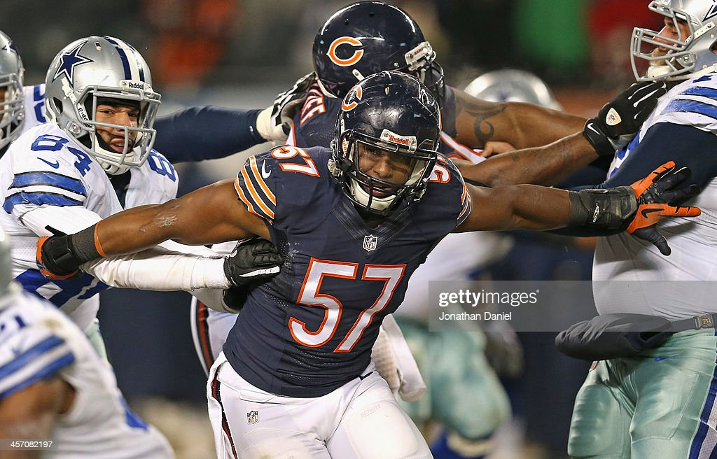 Jonathan Bostic #57 of the Chicago Bears moves through blockers including James Hanna #84 of the Dallas Cowboys at Soldier Field on December 9, 2013 in Chicago, Illinois. The Bears defeated the Cowboys 45-28.