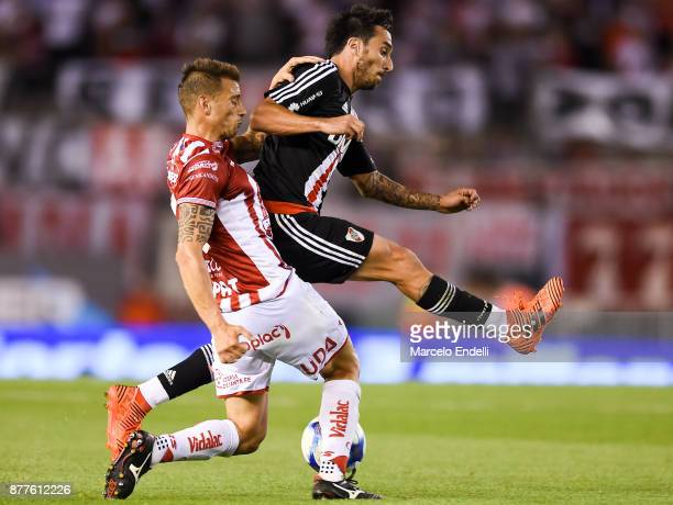 Jonathan Bottinelli of Union fights for ball with Ignacio Scocco of River Plate during a match between River and Union as part of Superliga 2017/18...