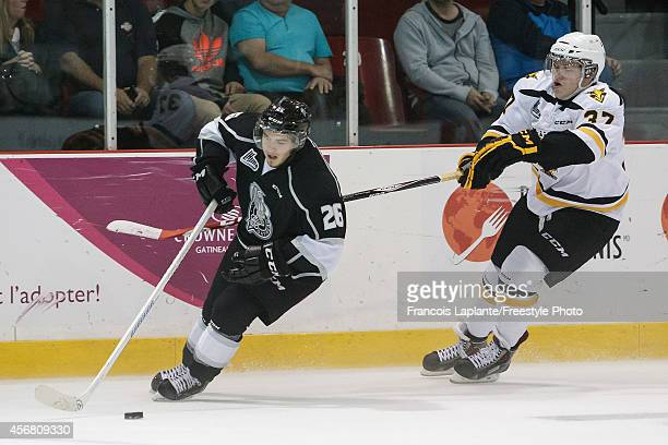 Jonathan Bourcier of the Gatineau Olympiques skates with the puck against Evgeny Svechnikov of the Cape Breton Screaming Eagles on September 25 2014...