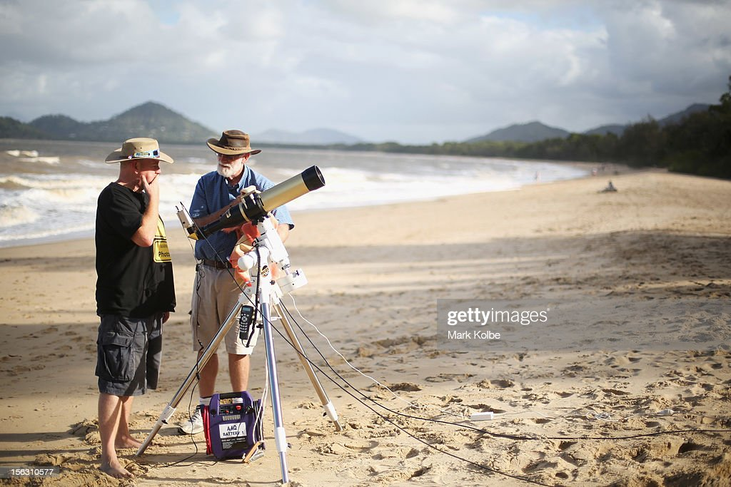 Jonathan Bradshaw and Terry Cuttle set up telescopic cameras and computer equipment on Palm Cove beach in preparation to run a live stream via NASA of the total solar eclipse on November 13, 2012 in Cairns, Australia. Thousands of eclipse-watchers have gathered in part of North Queensland to enjoy the solar eclipse, the first in Australia in a decade.