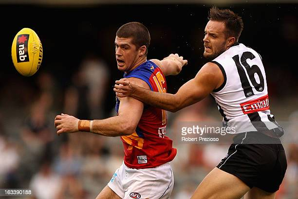 Jonathan Brown of the Lions and Nathan Brown of the Magpies contest the ball during the round three NAB Cup AFL match between the Collingwood Magpies...