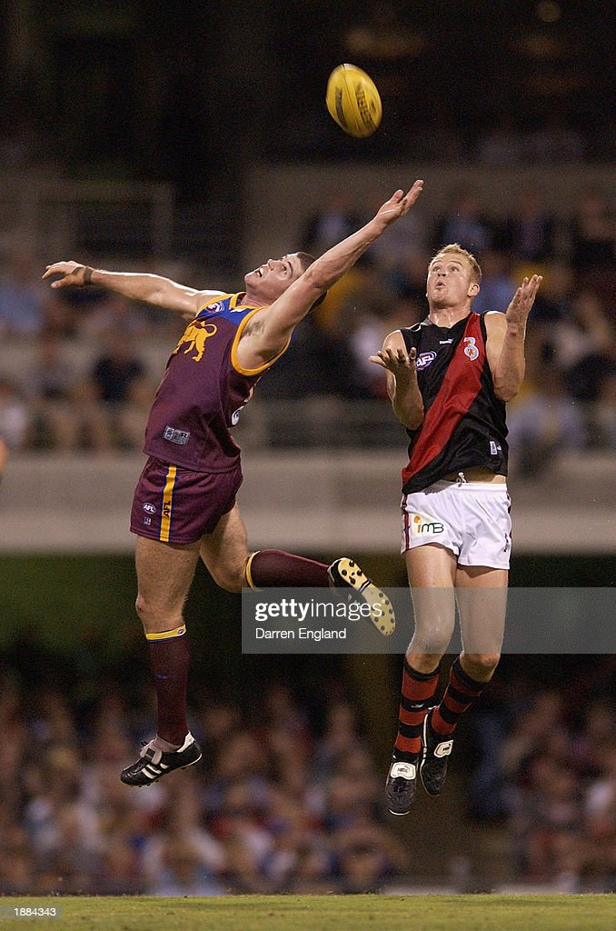 Jonathan Brown of the Lions in action against Sean Wellman of the Bombers during the round one AFL match played between the Brisbane Lions and the...
