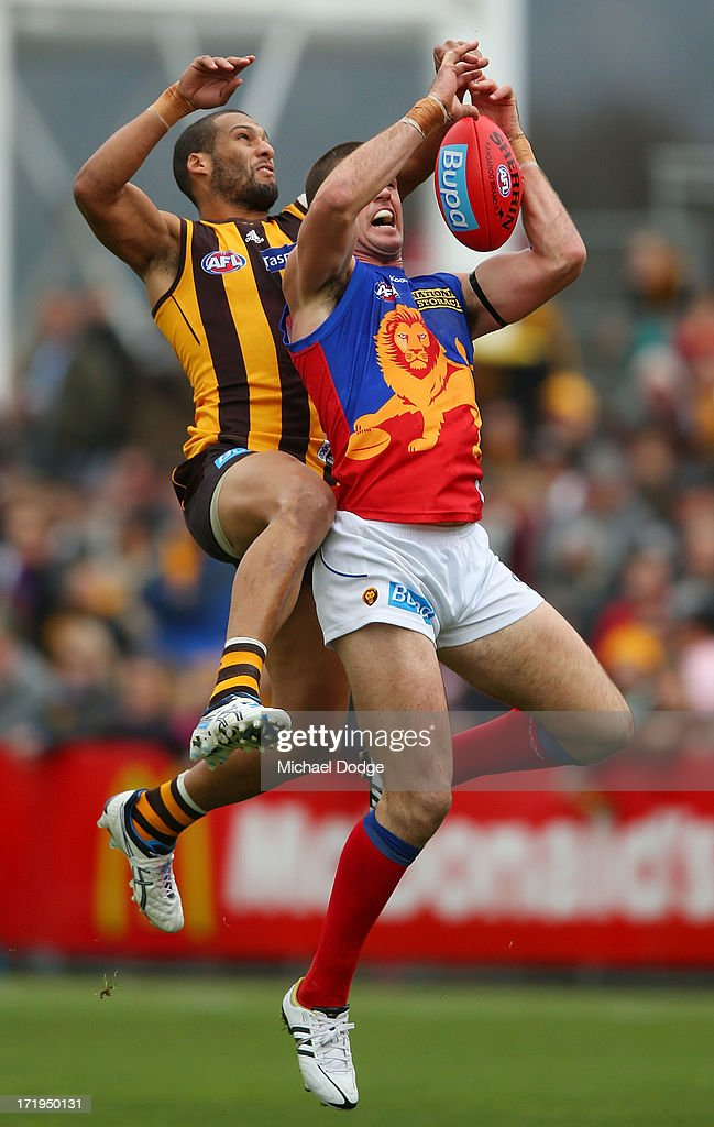 Jonathan Brown of the Lions marks the ball against Josh Gibson of the Hawks during the round 14 AFL match between the Hawthorn Hawks and the Brisbane Lions at Aurora Stadium on June 30, 2013 in Launceston, Australia.
