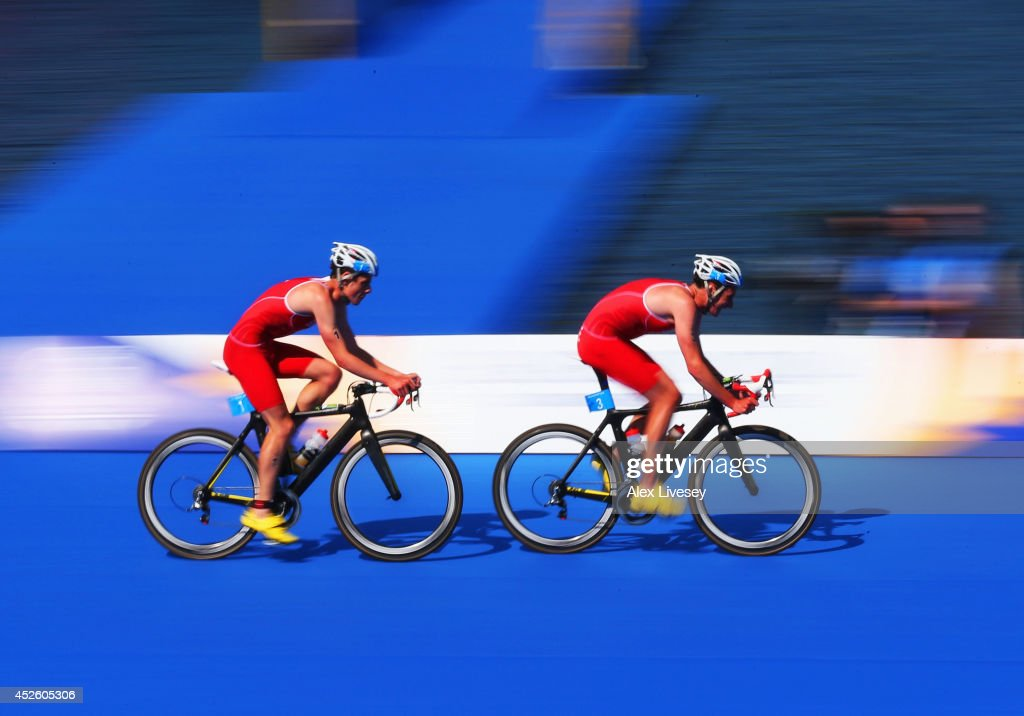 Jonathan Brownlee and Alistair Brownlee of England cycle in the Men's Triathlon final at Strathclyde Country Park during day one of the Glasgow 2014...