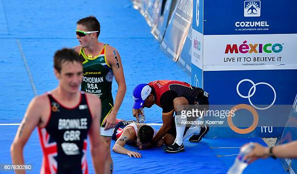 Jonathan Brownlee of Great Britain is helped by medical staff after collapsing of dehydration 200 meters before the finish line of the Men Elite ITU...