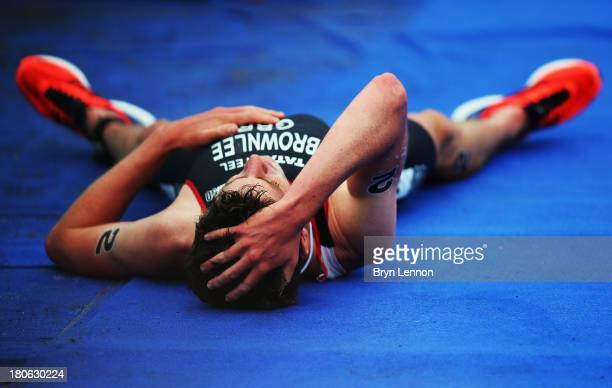 Jonathan Brownlee of Great Britain lies on the ground after finishing second in Elite Men's PruHealth World Triathlon Grand Final London and the ITU...