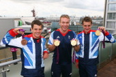 Jonathan Brownlee Sir Chris Hoy and Alistair Brownlee of Team GB pose with their medals at the adidas Olympic Media Lounge at Westfield Stratford...