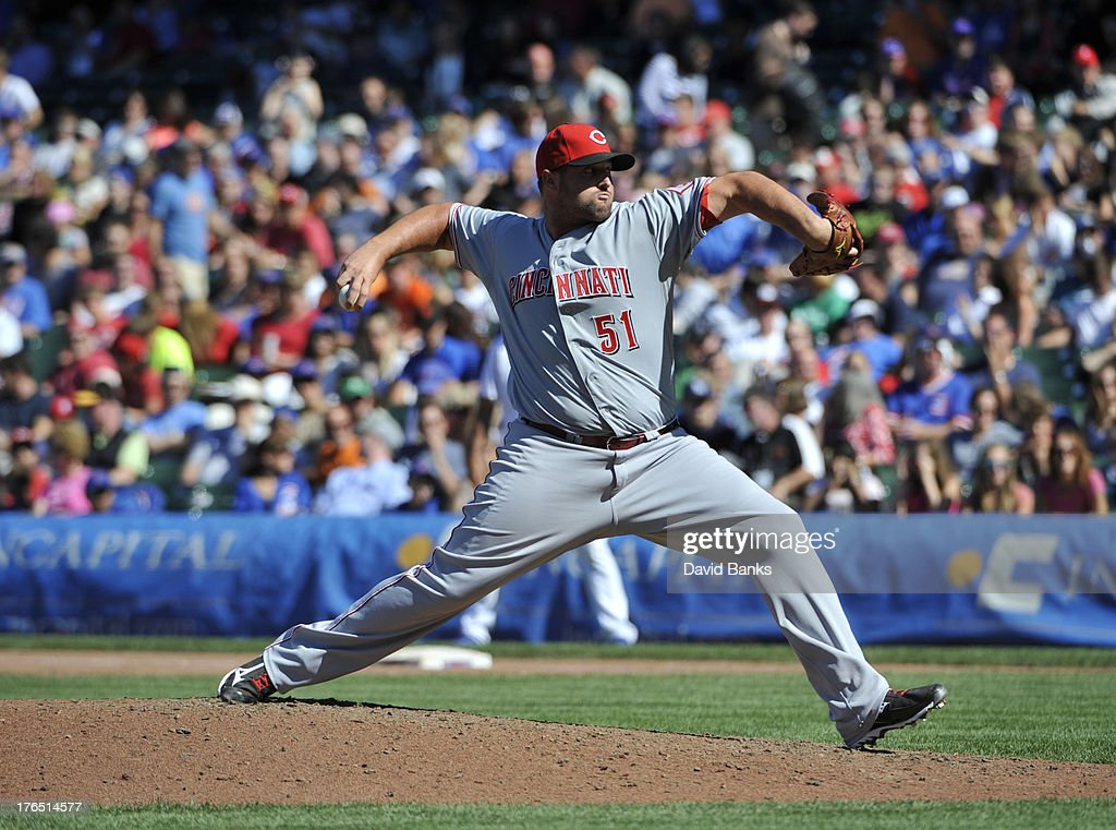 <a gi-track='captionPersonalityLinkClicked' href=/galleries/search?phrase=Jonathan+Broxton&family=editorial&specificpeople=551385 ng-click='$event.stopPropagation()'>Jonathan Broxton</a> #51 of the Cincinnati Reds pitches against the Chicago Cubs during the ninth inning on August 14, 2013 at Wrigley Field in Chicago, Illinois. The Cincinnati Reds defeated the Chicago Cubs 5-0.