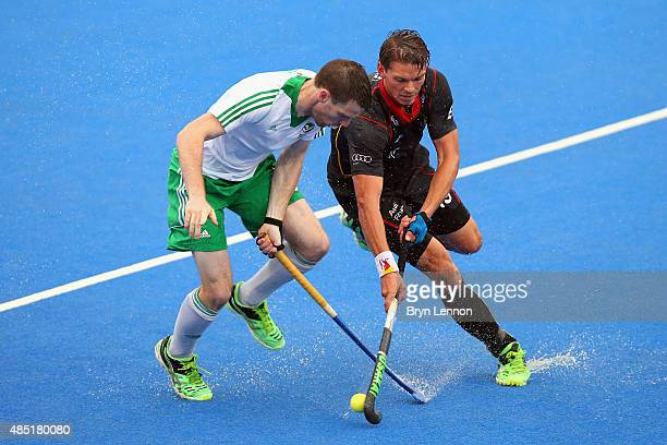 Jonathan Bruton of Ireland is tackled by Felix Denayer of Belgium during the match between Belgium and Ireland on day five of the Unibet EuroHockey...