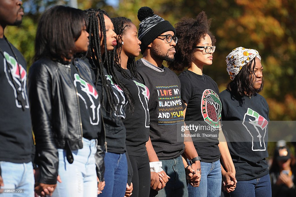 Jonathan Butler a University of Missouri grad student who did a 7 day hunger strike listens during a forum speaking to students on the campus of...