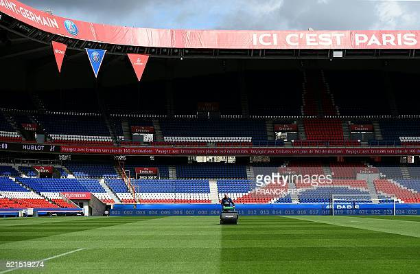 Jonathan Calderwood grounds manager for French Ligue 1 football team Paris SaintGermain uses a lawn mower at Parc des Princes stadium in Paris on...
