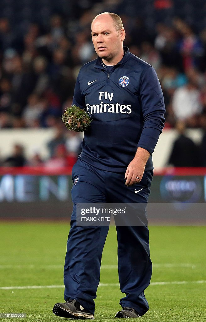Jonathan Calderwood, voted best 'Greenkeeper' Premier League checks the lawn at the half-time of the French L1 football match between Paris Saint-Germain and AS Monaco at the Parc des Princes Stadium in Paris on September 22, 2013.
