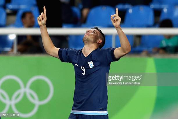 Jonathan Calleri of Argentina celebrates scoring the 2nd team goal during the Men's Group D first round match between Argentina and Algeria during...