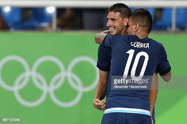 Jonathan Calleri of Argentina celebrates scoring the 2nd team goal with his team mate Angel Correa during the Men's Group D first round match between...
