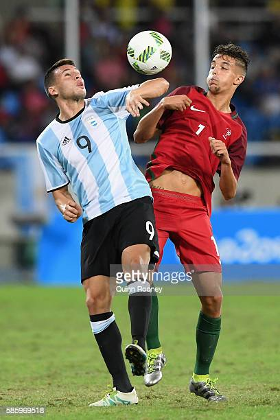 Jonathan Calleri of Argentina contests the ball during the Men's Group D first round match between Portugal and Argentina during the Rio 2016 Olympic...