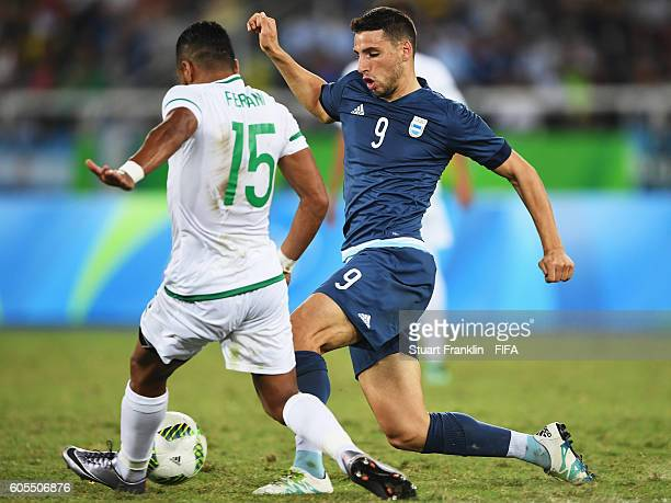 Jonathan Calleri of Argentina is challenged by Rachid Ait Atmane of Algeria during the Olympic Men's Football match between Argentina and Algeria at...