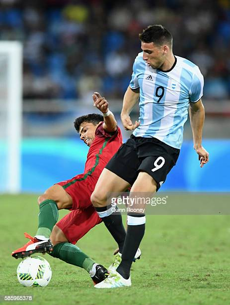Jonathan Calleri of Argentina is tackled during the Men's Group D first round match between Portugal and Argentina during the Rio 2016 Olympic Games...