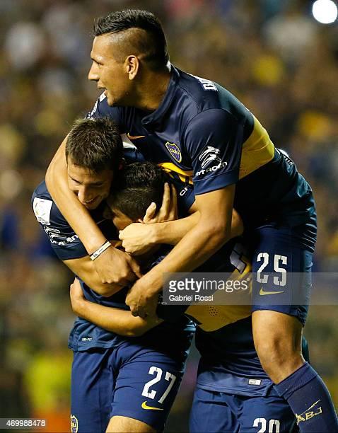 Jonathan Calleri of Boca Juniors celebrates with Guido Vadalá and Andres Chavez after scoring his team's second goal during a match between Boca...