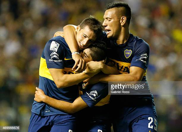 Jonathan Calleri of Boca Juniors celebrates with Guido Vadala and Andrés Chavez after scoring his team's second goal during a match between Boca...