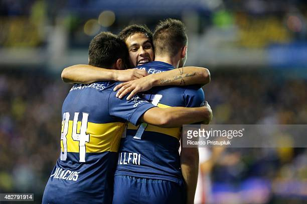 Jonathan Calleri of Boca Juniors celebrates with teammates after scoring the opening goal during a match between Boca Juniors and Union Santa Fe as...