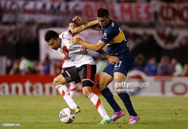 Jonathan Calleri of Boca Juniors fights for the ball with Leonel Vangioni of River Plate during a second leg semifinal match between River Plate and...